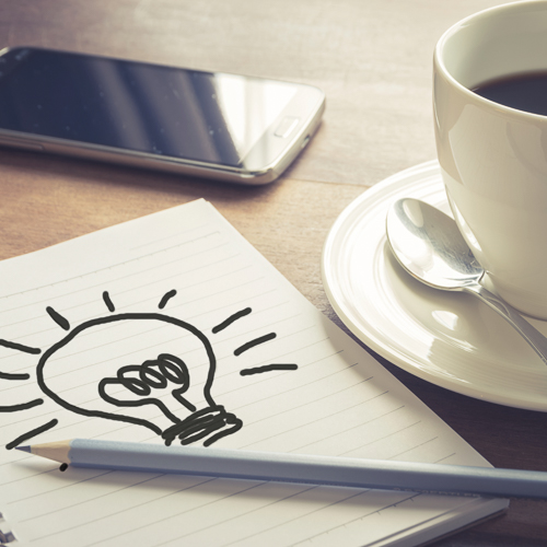 Write idea paper with coffee cup and smart phone,vintage filtered
